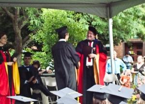 Nathen Gets Diploma (Grinning)